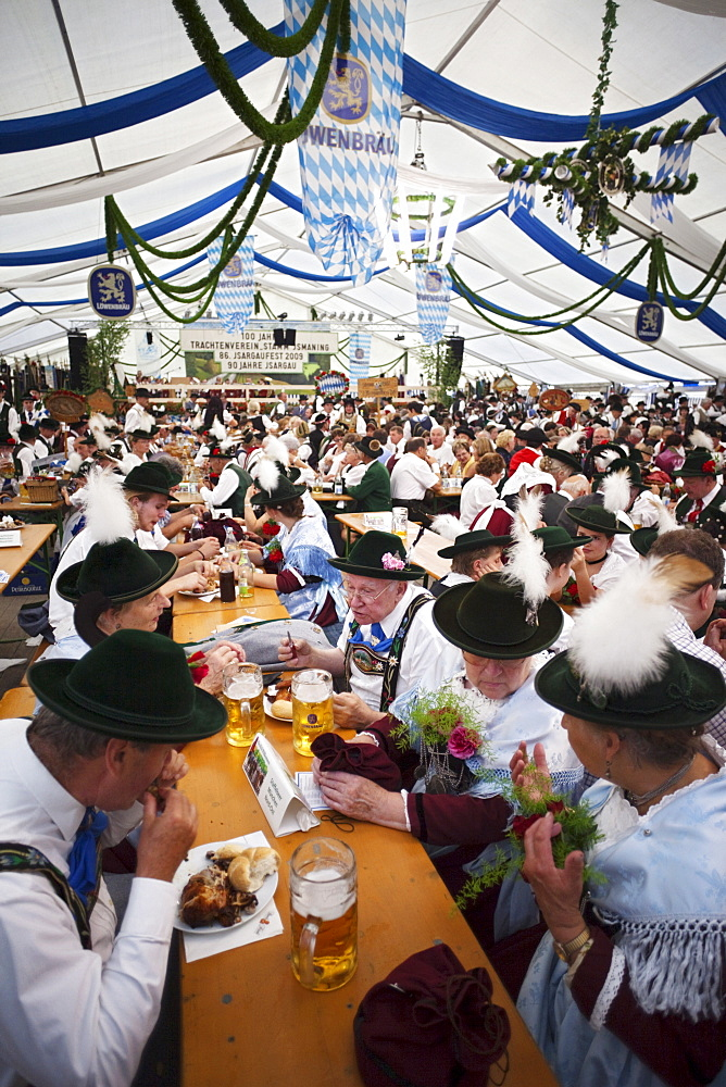 People in Bavarian costume inside beer tent, Oktoberfest, Munich, Bavaria, Germany - 834-1497
