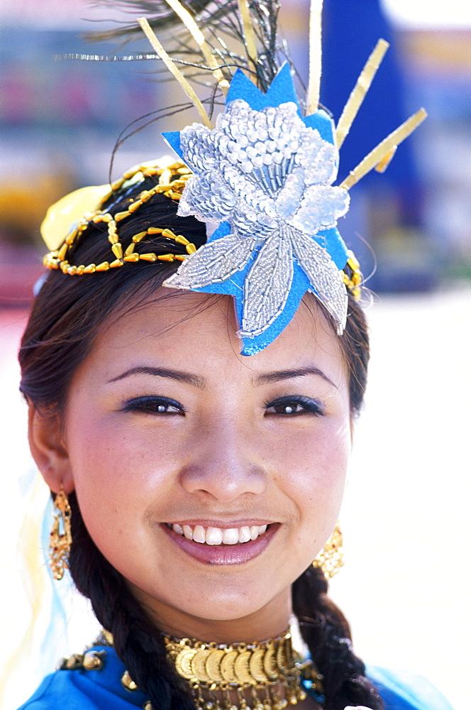Uigur Minority woman dressed in Uigur costume, Urumqi, Xinjiang Province, China, Asia