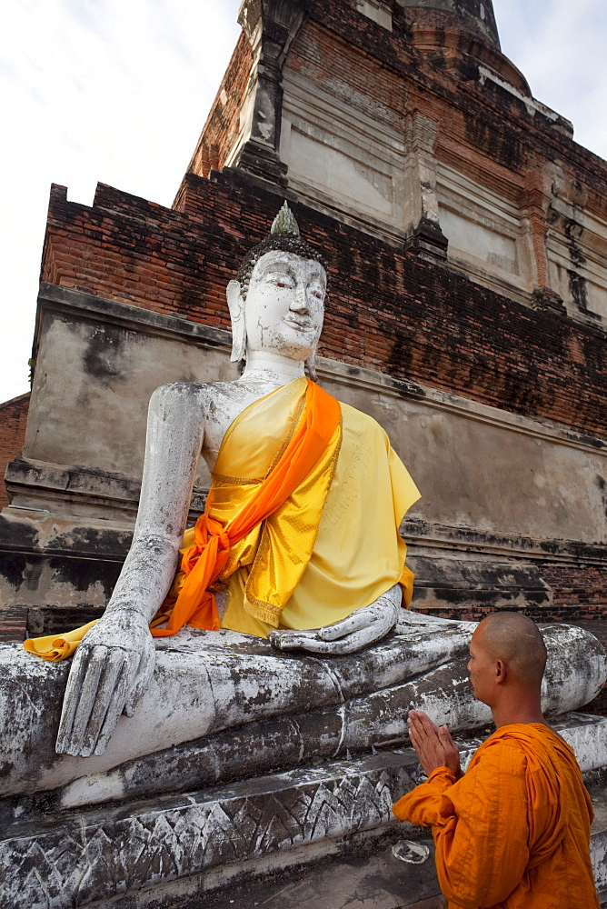 Monk in front of Buddha statue at Wat Yai Chai Mongkhon, Ayutthaya Historical Park, UNESCO World Heritage Site, Ayutthaya, Thailand, Southeast Asia, Asia