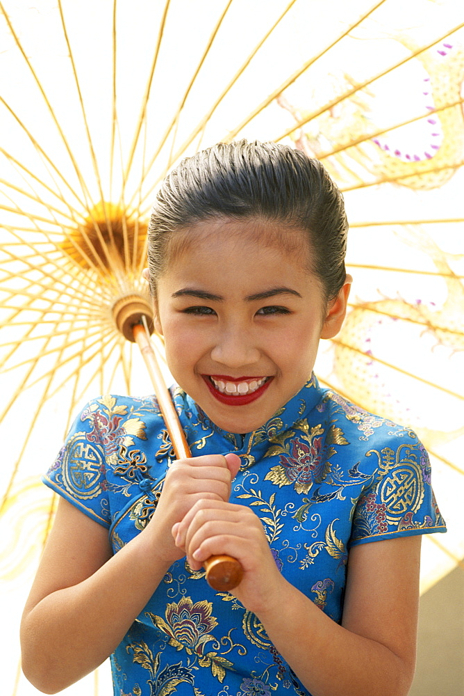 Young girl in traditional Chinese dress (Cheongsam), Beijing, China, Asia