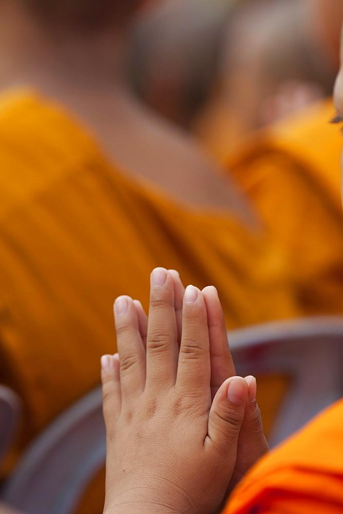 Hands of young monk praying, Ayutthaya Historical Park, Ayutthaya, Thailand, Southeast Asia, Asia