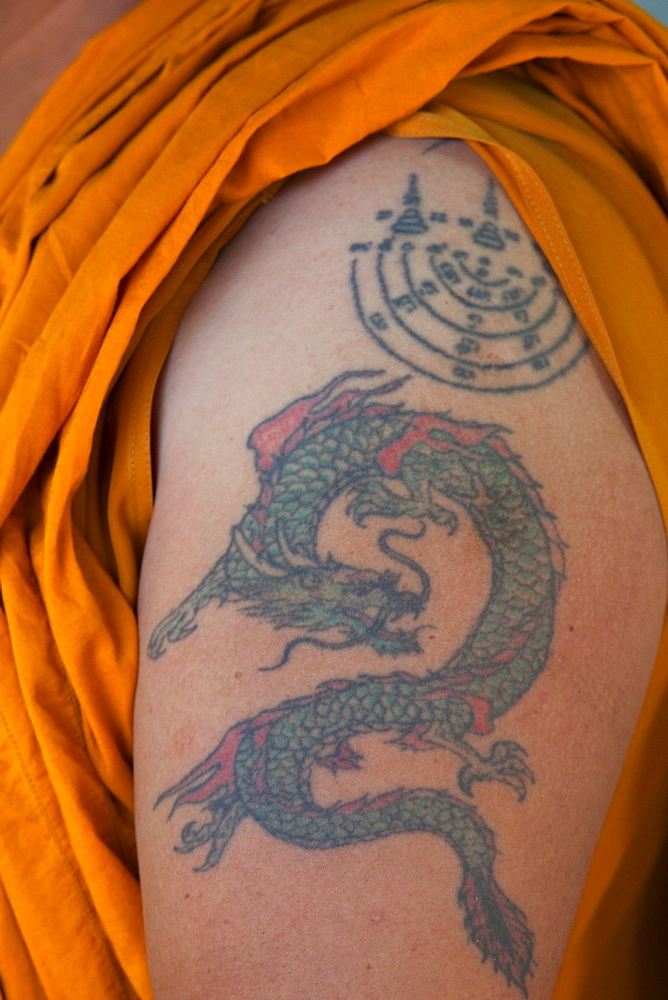 Monk with dragon tatoo on upper arm, Bangkok, Thailand, Southeast Asia, Asia