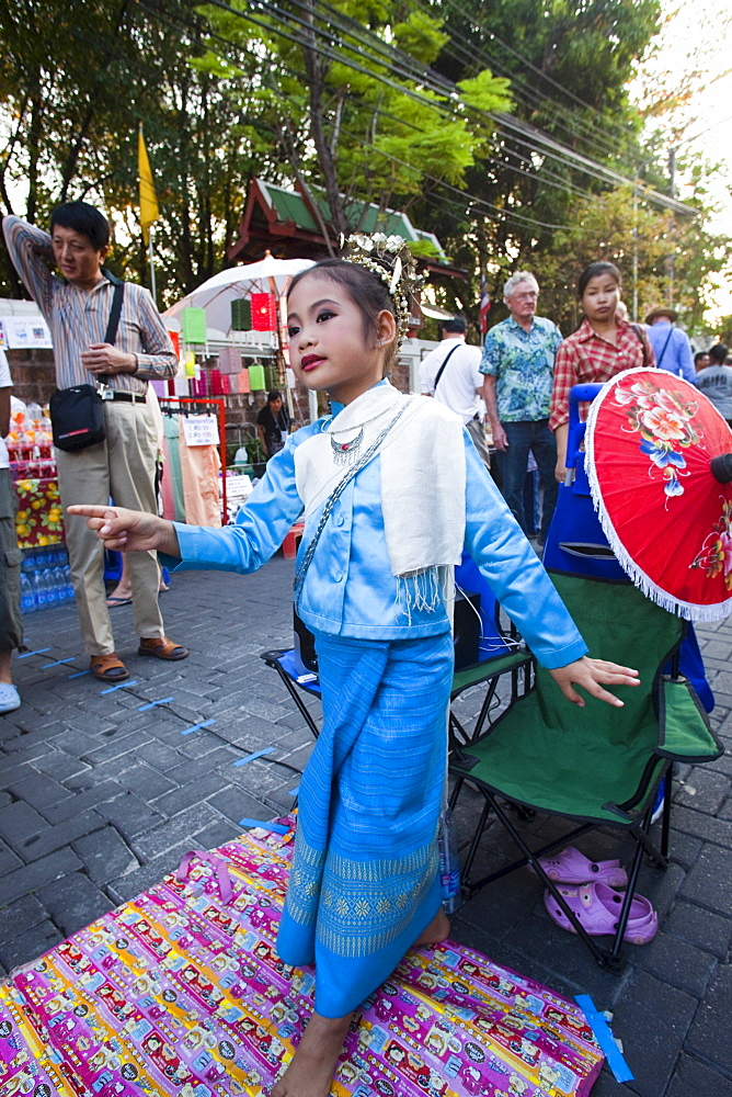 Young street performer, Sunday Street Market, Chiang Mai, Thailand, Southeast Asia, Asia