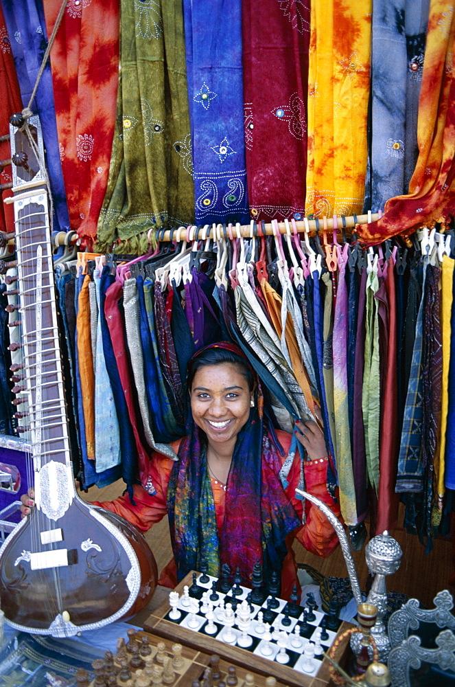 Vendor selling batiks and local crafts, Anjuna Market, Goa, India, Asia