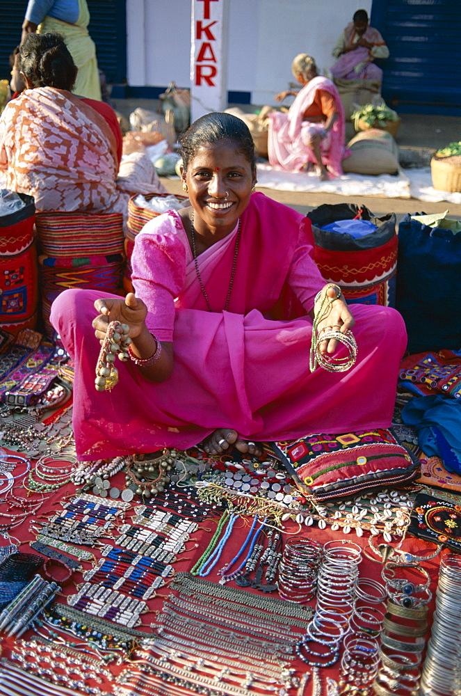 Vendor selling jewellery, Anjuna Market, Goa, India, Asia