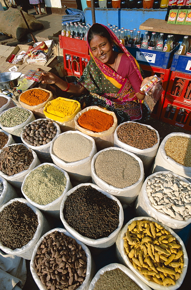 Vendor selling curry powder and spices, Anjuna Market, Goa, India, Asia