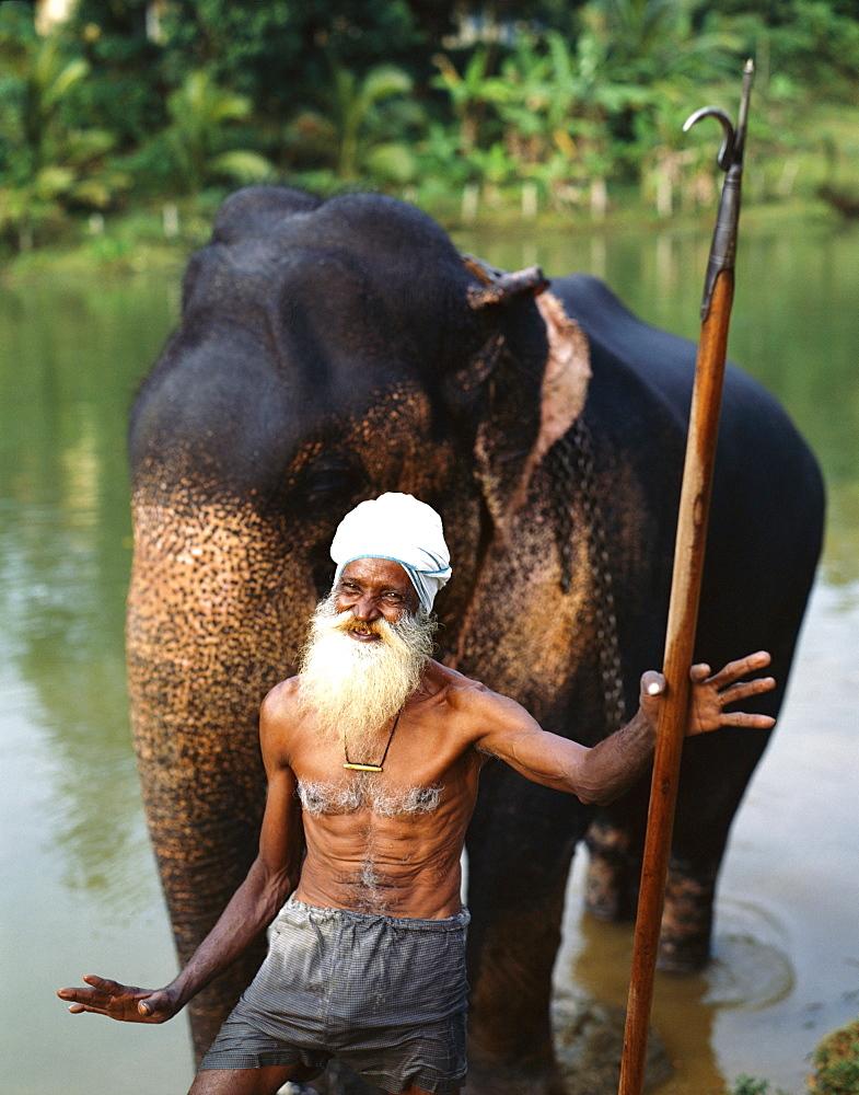 Elephant trainer, Pinnawala Elephant Orphanage, near Kandy, Sri Lanka, Asia
