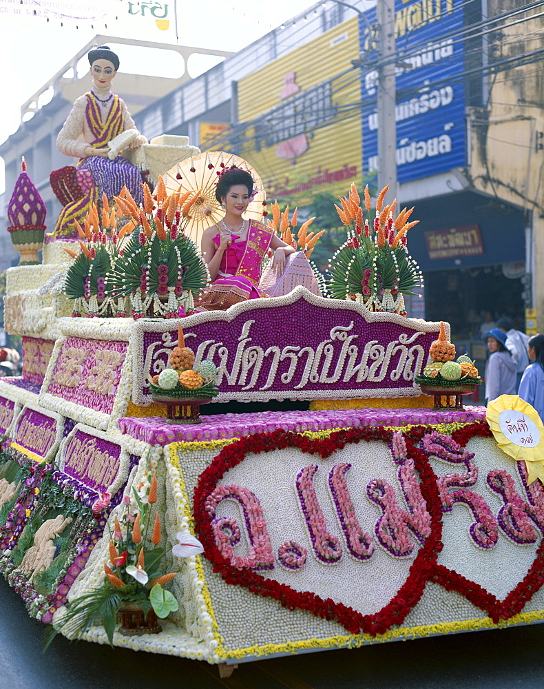 Woman dressed in traditional costume on a floral float, Flower Festival, Chiang Mai, Thailand, Southeast Asia, Asia