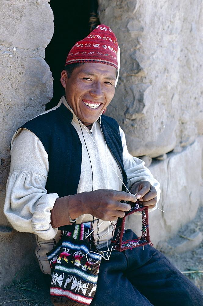 Man knitting, Taquile Island, Lake Titicaca, Peru, South America