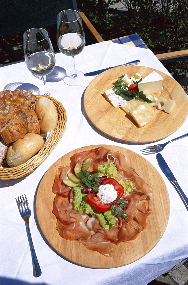 Regional cuisine of cured ham (speck) and cheese, Villnoss, Val di Funes, Trentino, Italy, Europe