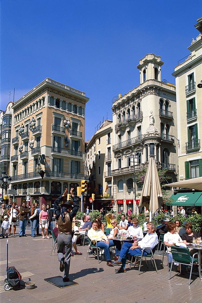 Outdoor cafes and street performer, La Ramblas, Barcelona, Catalonia, Spain, Europe