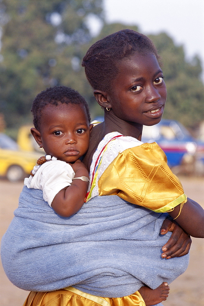 African girl carrying baby on back, Banjul, Gambia, West Africa, Africa