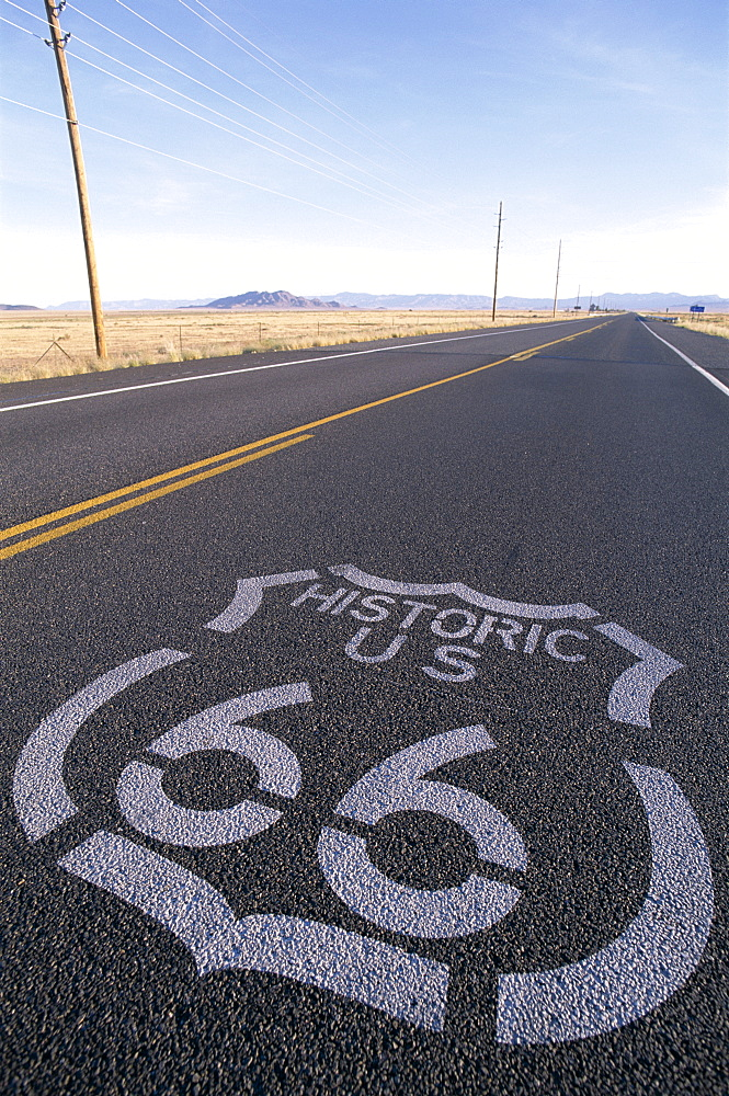 Route 66 sign on empty Road, Historic Route 66 Highway, Seligman, Arizona, United States of America, North America