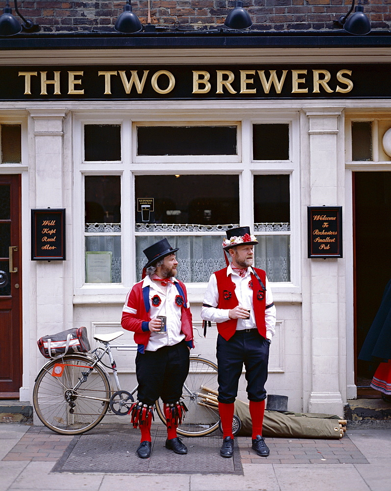 Two Morris Dancers drinking outside pub, Rochester, Kent, England, United Kingdom, Europe