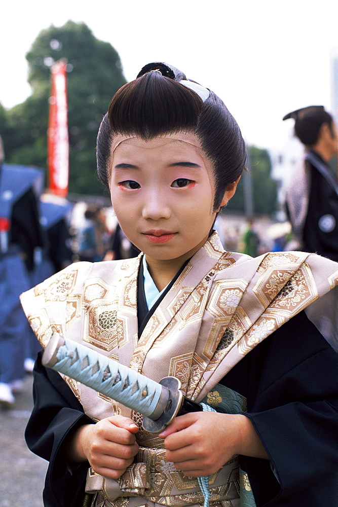 Boy dressed in Samurai costume at Jidai Matsuri Festival held annually in November at Sensoji Temple Asakusa, Tokyo, Honshu, Japan, Asia - 834-4674