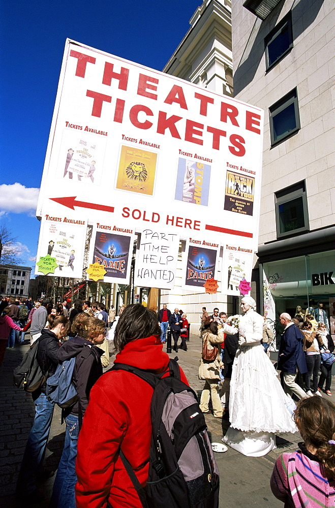 Sandwich board man advertising theatre tickets and street performer, Covent Garden, London, England, United Kingdom, Europe