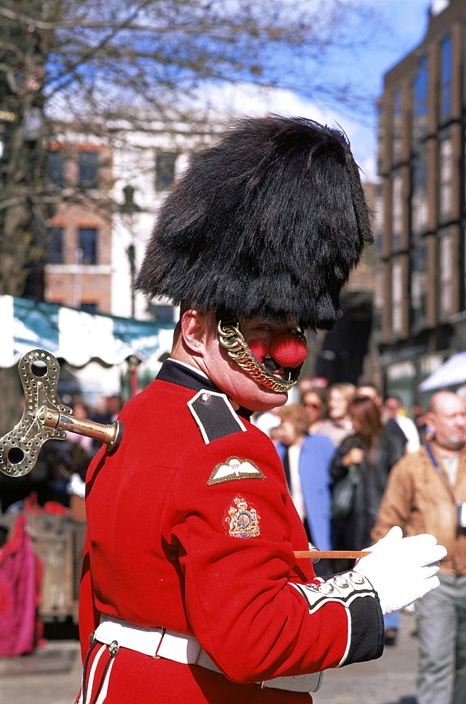 Street performer dressed as a guardsman, Covent Garden, London, England, United Kingdom, Europe