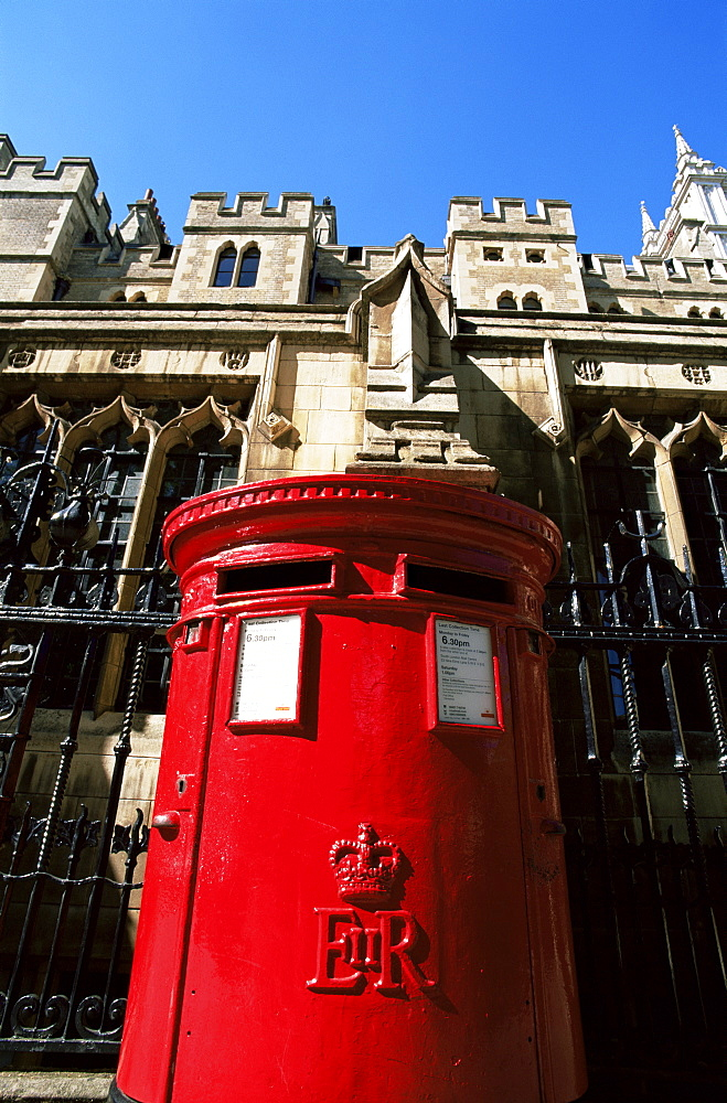 Traditional postbox and Westminster Abbey in the background, London, England, United Kingdom, Europe