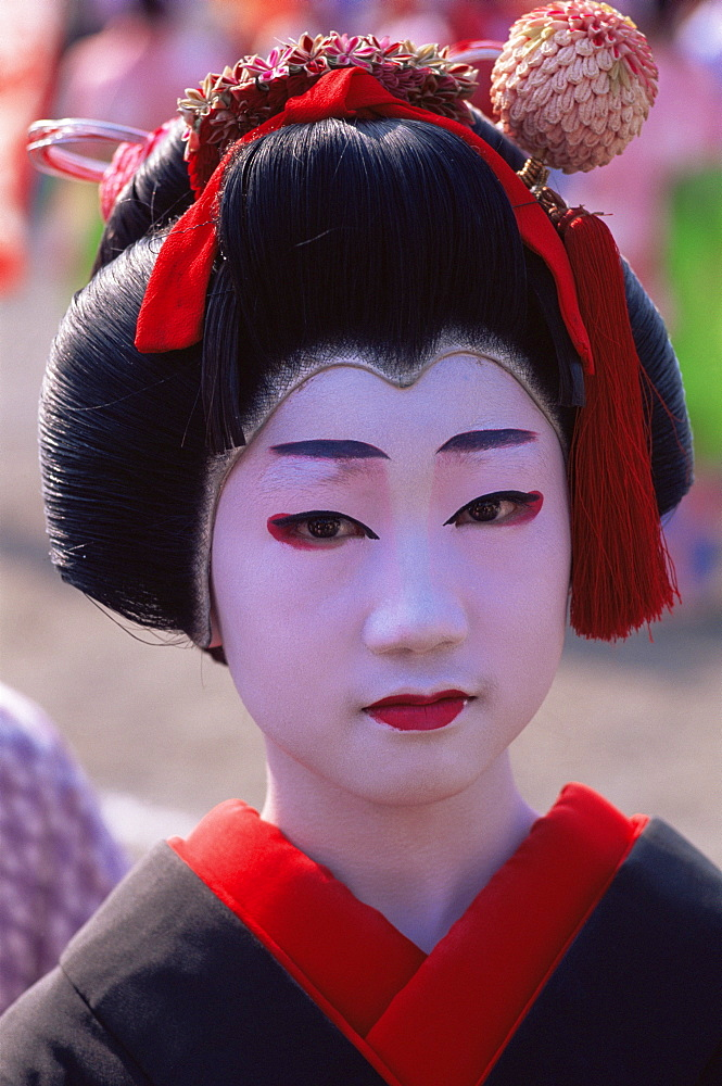 Young girl dressed as a geisha at the Jidai Matsuri Festival held annually in November at Sensoji Temple, Asakusa, Tokyo, Japan, Asia