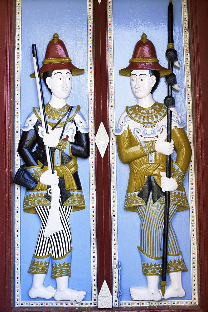 Door carving detail of royal guards, Grand Palace, Bangkok, Thailand, Southeast Asia, Asia
