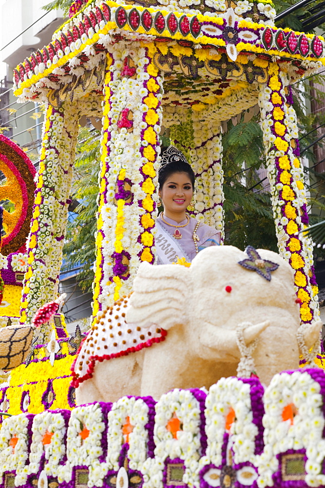 Girl on floral float at Chiang Mai Flower Festival Parade, Chiang Mai, Thailand, Southeast Asia, Asia