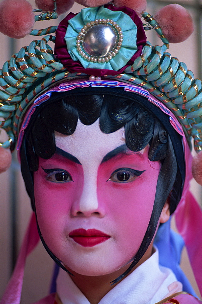 Portrait of boy dressed in Chinese Opera costume, Hong Kong, China, Asia