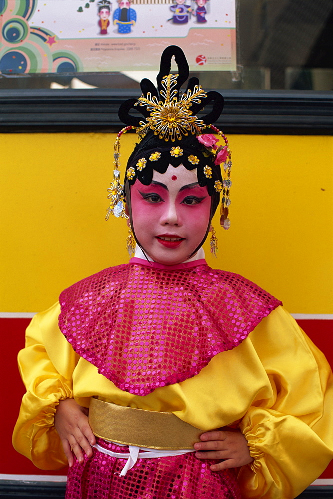 Portrait of child dressed in Chinese Opera costume, Hong Kong, China, Asia