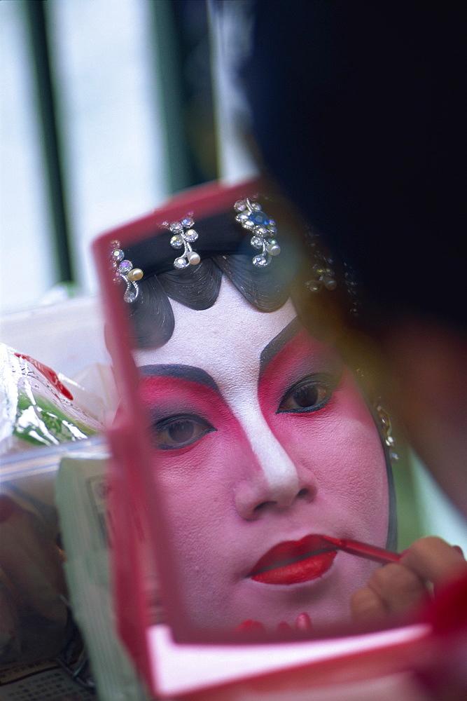 Portrait of Chinese Opera actress applying make-up, Hong Kong, China, Asia