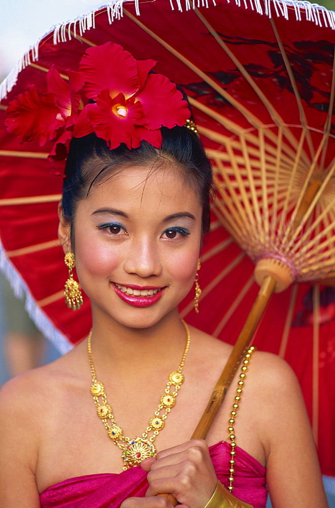 Portrait of a girl in traditional Thai costume with flowers in her hair, Chiang Mai Flower Festival Parade, Chiang Mai, Thailand, Southeast Asia, Asia