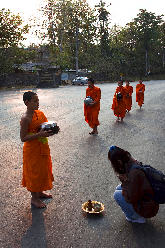 Monks receiving offerings of food, Chiang Mai, Thailand, Southeast Asia, Asia