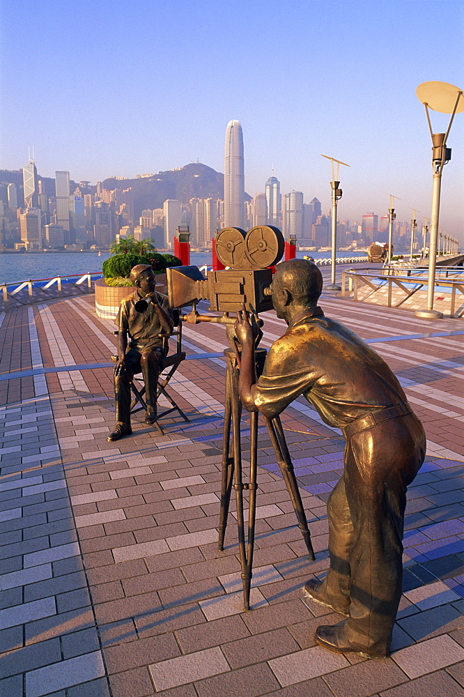 The Producers statue with city skyline in the background, Avenue of the Stars, Tsim Sha Tsui, Kowloon, Hong Kong, China, Asia