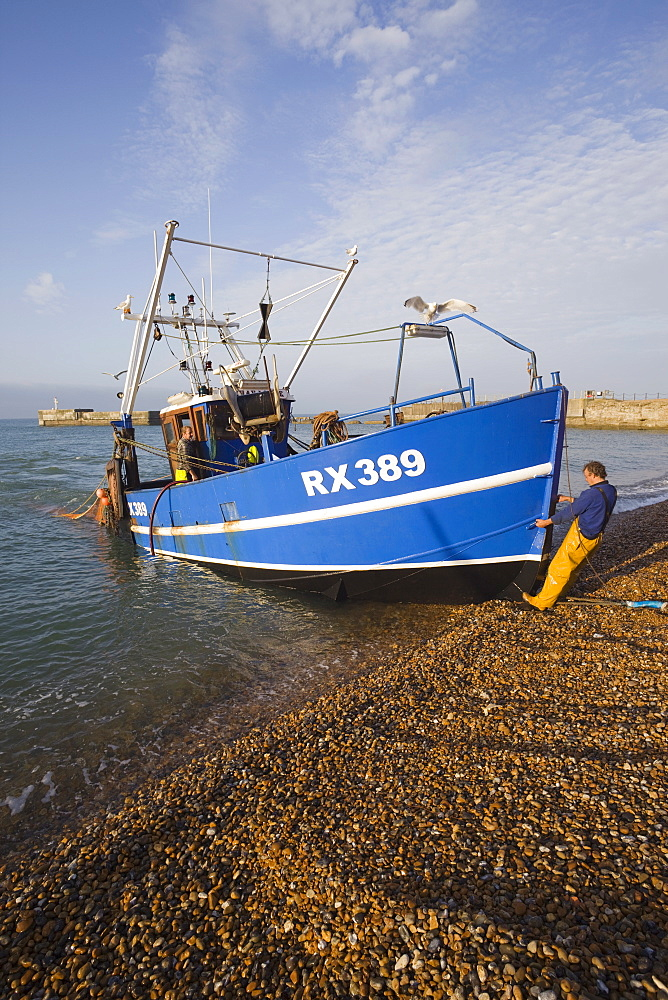 The Stade, shore based fishing boat returning to port, Hastings, East Sussex, England, United Kingdom, Europe