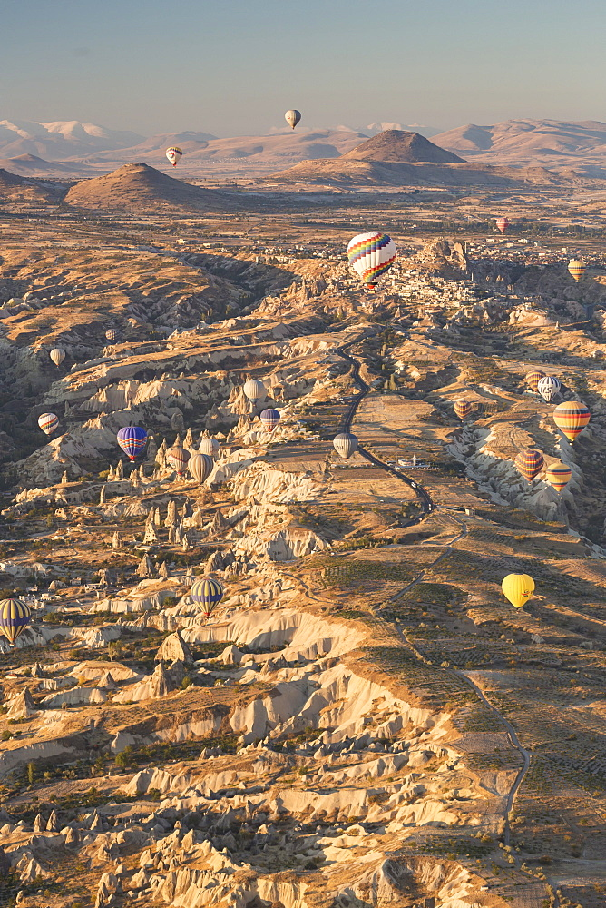 Hot air balloons rising into the dawn sky above Goreme, Cappadocia, Anatolia, Turkey, Asia Minor, Eurasia - 835-81