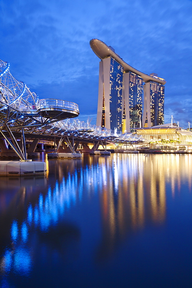 Marina Bay Sands Hotel and the Helix bridge at dusk in Singapore, Southeast Asia, Asia - 835-92