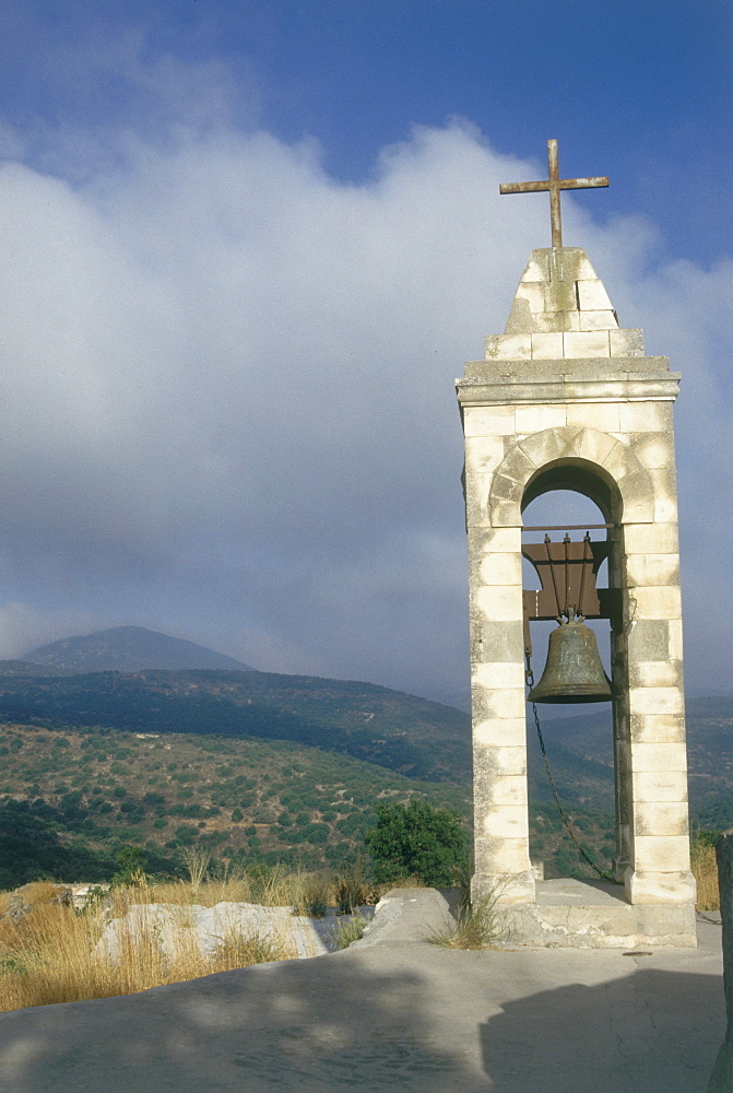 Photograph of a bell tower with a cross on it near the ruins of Baram in the Upper Galilee, Israel