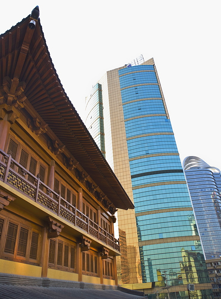 Traditional Chinese wooden architecture next to modern Chinese glass and steel buildings, Shanghai, China, Asia - 839-25