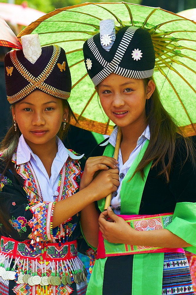 Young Hmong women in traditional dress, Lao New Year festival, Luang Prabang, Laos, Indochina, Southeast Asia, Asia