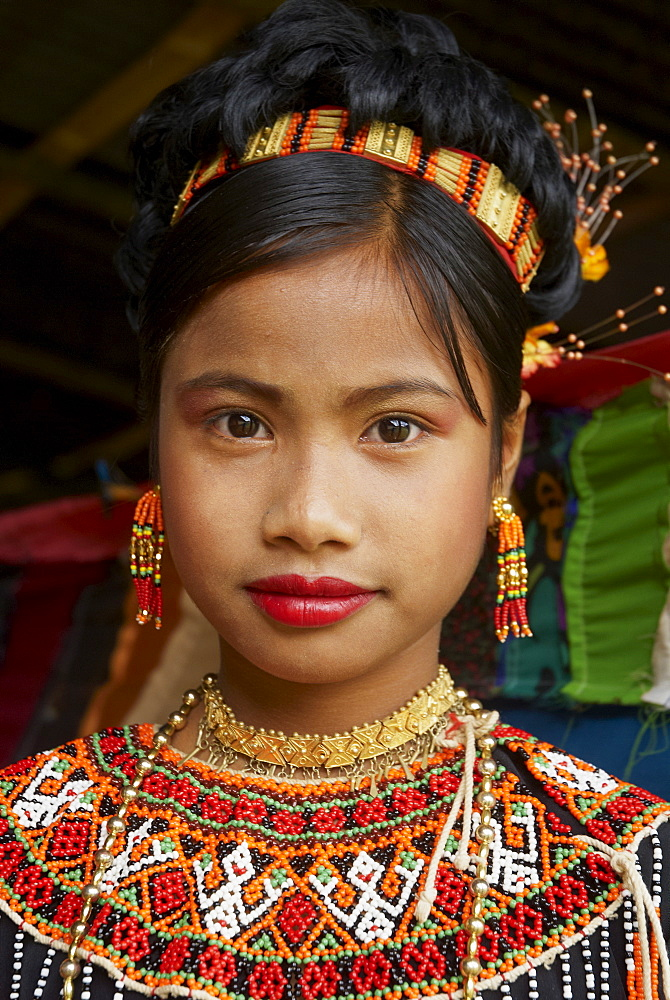 Young Toraja girl in traditional costume at funeral ceremony, Tana Toraja, Sulawesi, Celebes, Indonesia, Southeast Asia, Asia