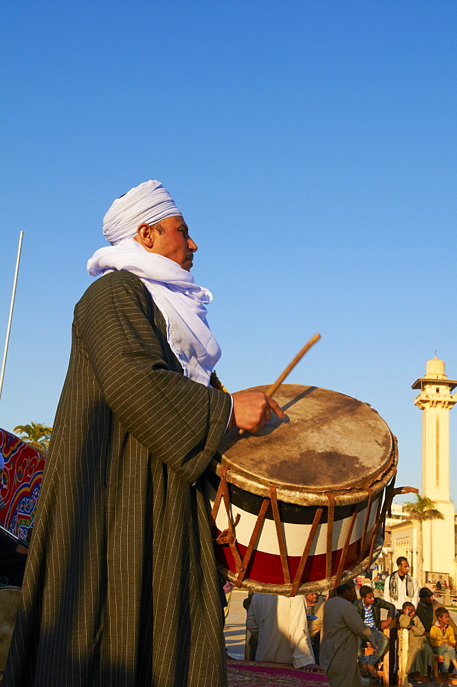 Drummer at Tahtib demonstration, a traditional form of Egyptian folk dance involving a wooden stick, also known as stick dance or cane dance, Mosque of Abu el-Haggag, Luxor, Egypt, North Africa, Africa