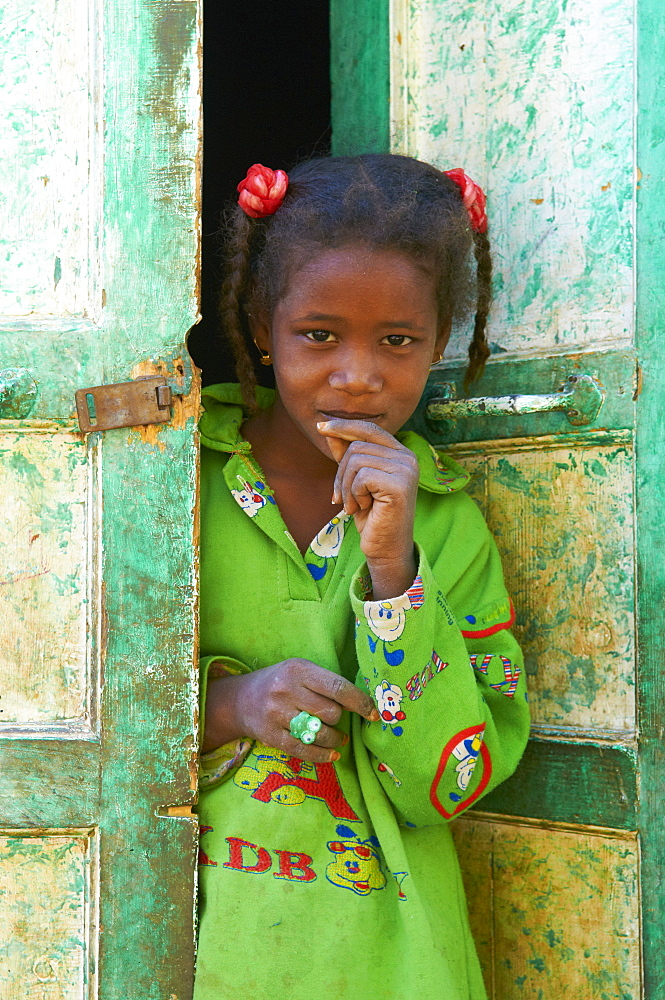 Girl in Nubian painted village near Aswan, Egypt, North Africa, Africa
