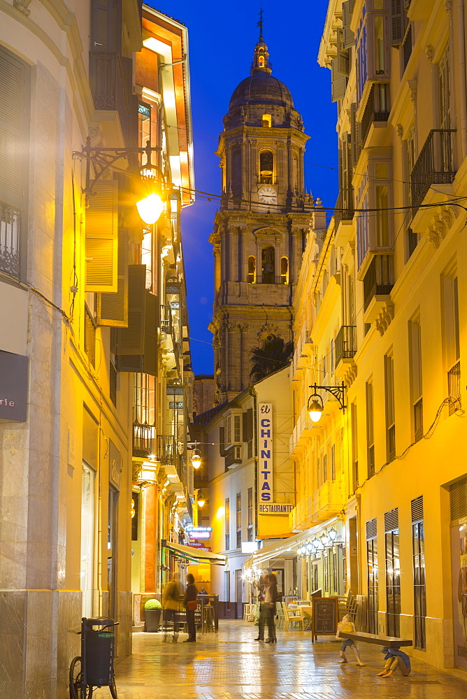 View of Malaga Cathedral from Calle Marques de Larios at dusk, Malaga, Costa del Sol, Andalusia, Spain, Europe