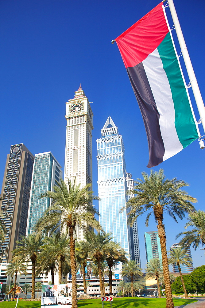 Skyscrapers on Sheikh Zayed Road and the Emirates flag, Dubai, United Arab Emirates, Middle East