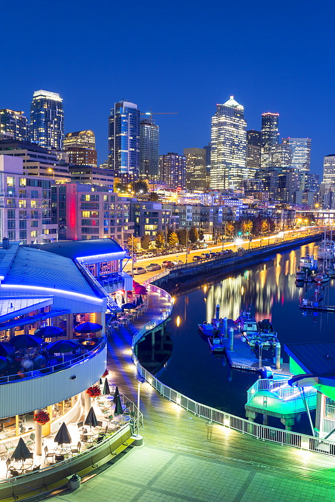 Elevated view of Seattle skyline and restaurants in Bell Harbour Marina at dusk, Belltown District, Seattle, Washington State, United States of America, North America