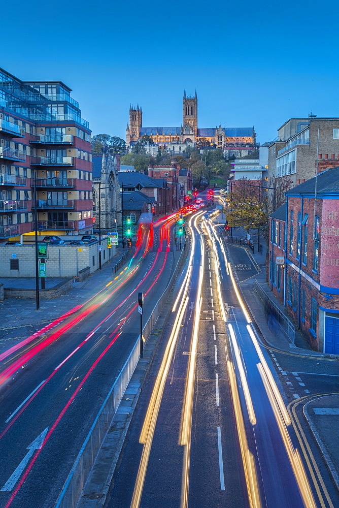 View of Lincoln Cathedral and traffic on Broadgate at dusk, Lincoln, Lincolnshire, England, United Kingdom, Europe