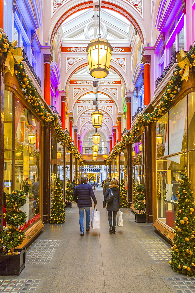 Christmas decorations and shoppers in The Royal Arcade, Mayfair, London, England, United Kingdom, Europe