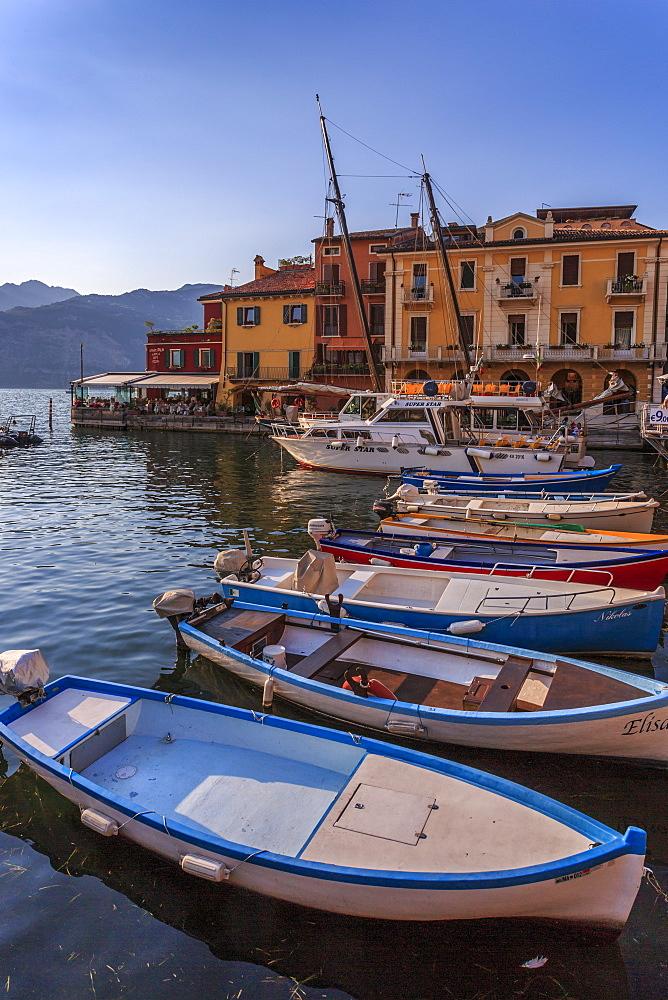 View of boats in Malcesine Harbour by the Lake, Malcesine, Lake Garda, Veneto, Italian Lakes, Italy, Europe