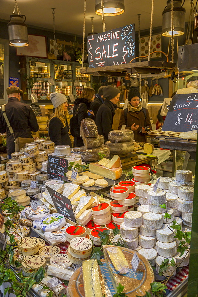 Various cheeses on a stall in Borough Market, Southwark, London, England, United Kingdom, Europe