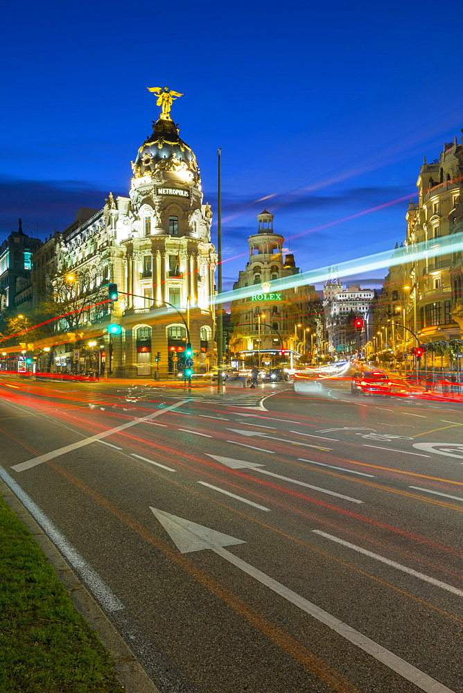 View of trail lights on Calle de Alcala and the entry to Gran Via at dusk, Madrid, Spain, Europe