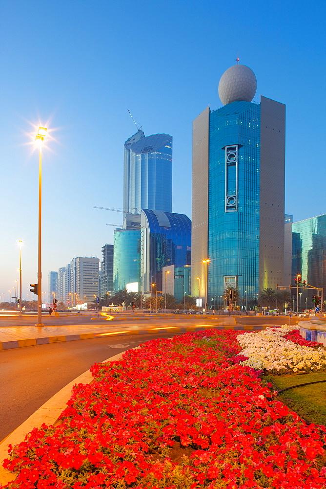 Contemporary architecture on Rashid Bin Saeed Al Maktoum Street at dusk, Abu Dhabi, United Arab Emirates, Middle East