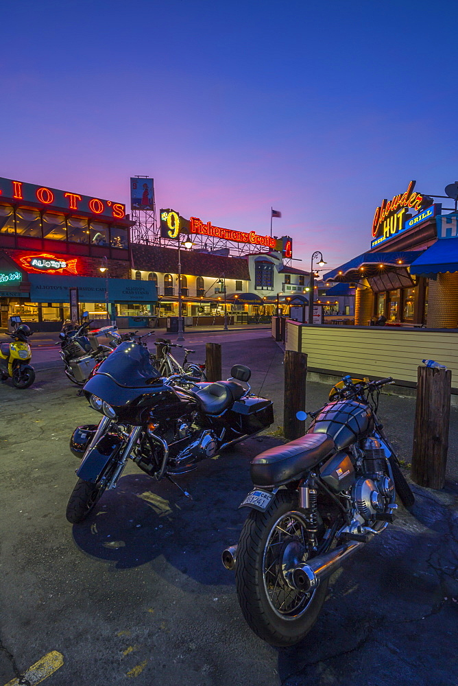 Motorbikes outside Fishermans Wharf cafes and restaurants at dusk, San Francisco, California, United States of America, North America - 844-17003